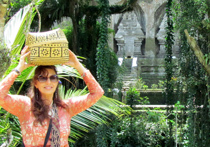 A woman holding a basket in nature preserve setting.